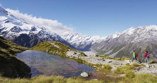 Hiking travel nature hikers in New Zealand Mount Cook landscape Live Action