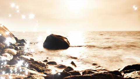 Lens defect. Shining and glittering sea waves and boulders sticking up from Image