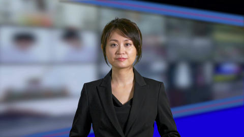Asian Chinese businesswoman or presenter presenting with tv no mic slant Footage