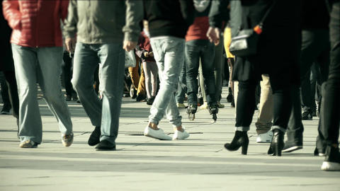 Unrecognizable people feet walking along pedestrian city street Footage