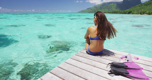 Luxury lifestyle vacation holiday travel bikini woman relaxing after snorkel Footage