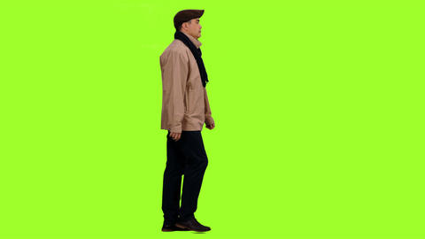 Adult man walks and changes clothes according to the seasons, Chroma key Footage