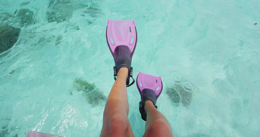 Cute feet snorkeler playful having fun with pink snorkel fins over ocean beach Footage