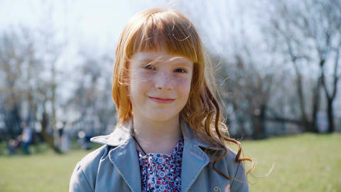 little ginger girl with freckles smiling Footage