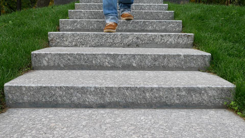 Man in Blue Jeans Goes on Granite Steps at the Memorial Footage