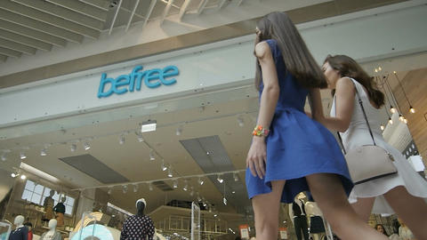 Slow Motion Camera Shows Girls Coming to Befree Clothes Store Footage