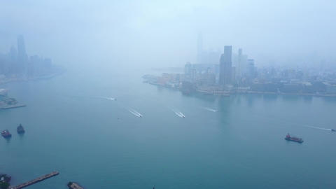 Clouded aerial panorama of Victoria Harbour at early morning Live Action