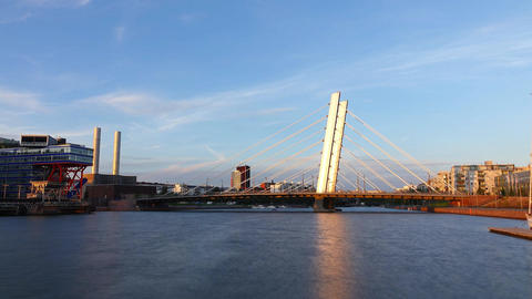 Crusell Bridge at sunset, time lapse shot, sun light reflected in steel pylon Live Action