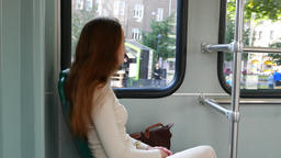 Young adult woman travel by Helsinki Tram, sit in moving…, Live Action