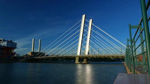 Evening time lapse shot of modern cable stayed bridge across city channel Footage