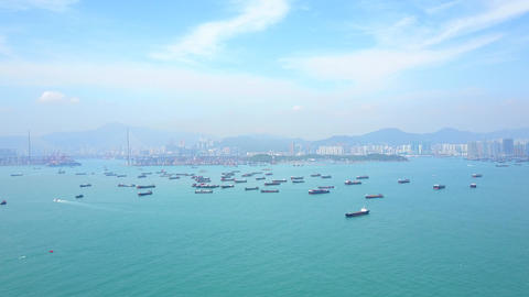 Many small container ships anchored at Victoria Harbour, wide angle aerial shot GIF