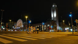 People come at pedestrian crossing to central railway station, night time Footage