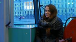 Pretty woman travel in Helsinki tram, ride at Senate... Stock Video Footage