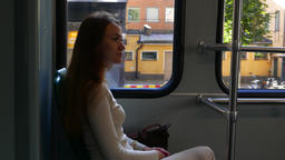 Young adult woman travel in city by tram, portrait of passenger Footage