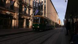 Deep shadows and sun light at Aleksanterinkatu street, tram move towards stop Footage