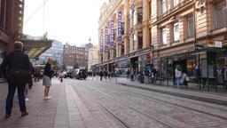 Citizens wait tram at Aleksanterinkatu street stop, typical Helsinki view Footage