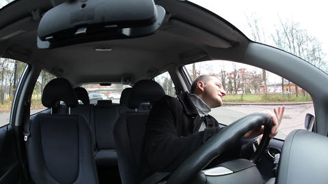 Man sit in car and wait for passenger, fisheye view of vehicle interior GIF