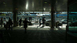 Calm arrival ramp at modern airport, taxi cars, passenger silhouettes GIF