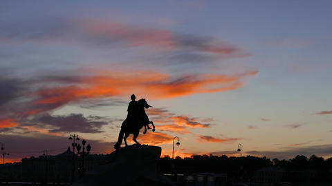 Silhouetted Peter The Great equestrian statue against darkening sky, timelapse GIF