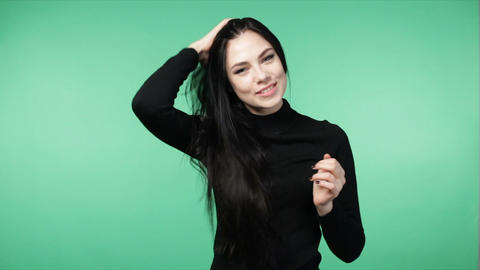 brunette woman playing with long beautiful hair Footage