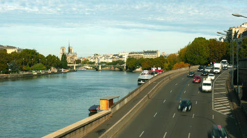 Time lapse of car traffic on the Seine river embankment in Paris and distant Footage