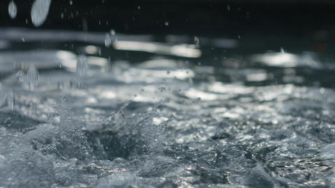 Splashes of water from a fountain - closeup 4K UHD footage Bild