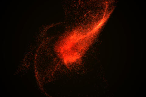 Abstract background made of red glowing particles フォト