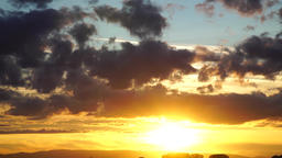 Golden sunset with clouds, time lapse Footage