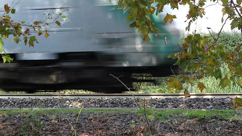 Closeup of the moving train and the railroad in countryside Footage