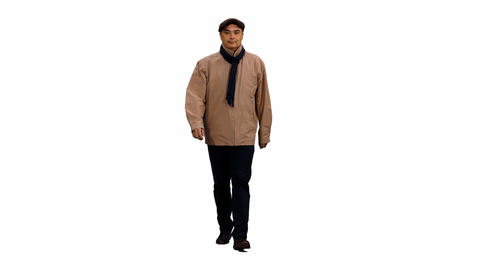 Front view of adult man walks and changes clothes according to the seasons Footage