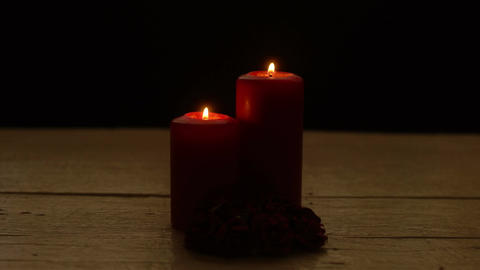 Two red candles burn and roses in romantic time on wood table Image