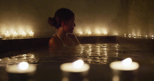 Happy Beautiful Woman Relaxing In Jacuzzi At Lit Beauty Spa 영상물
