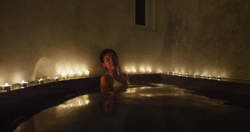 Woman enjoying soothing hydrotherapy massage water jets in jacuzzi bath tub spa Live Action