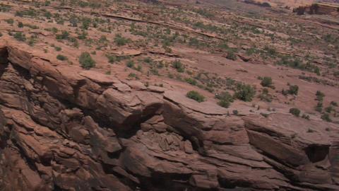 Biking on tall cliffs Live Action