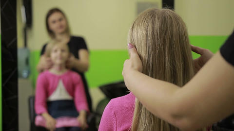 Female hairdresser arranging hairdo in barber shop Footage
