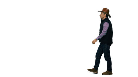 Side view of a man in a cowboy hat walking on transparent background Footage