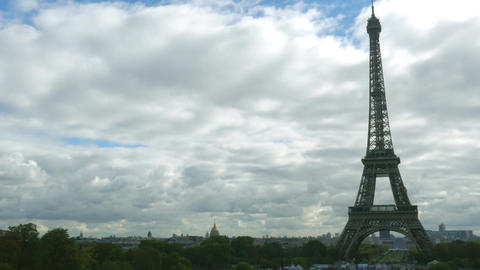 Time lapse of the Eiffel tower against partly cloudy sky Footage