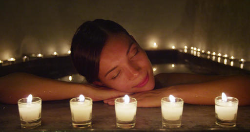 Beautiful Woman Resting Head On The Edge Of Jacuzzi At Beauty Spa Footage
