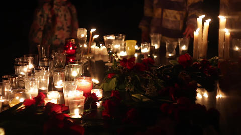 Terrorist attack, people mourn. Flowers and candles in memory of those killed by Live Action