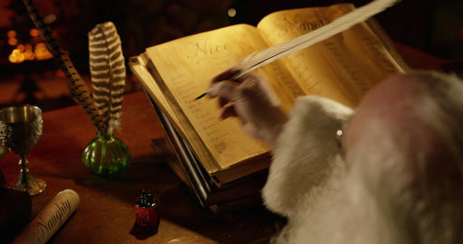 Santa adjusts Nice List with a feather quill in the North Pole at Christmas Live Action