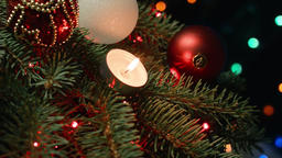 Christmas candles on the Christmas tree with garland Footage
