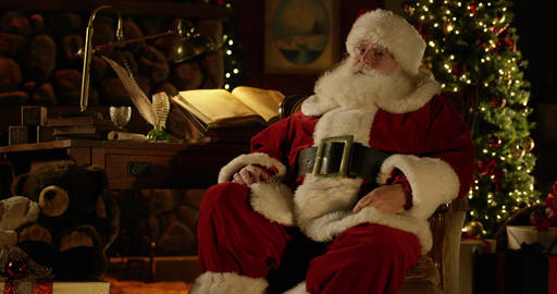 Santa glances back at Naughty/Nice Christmas list in North Pole workshop Live Action
