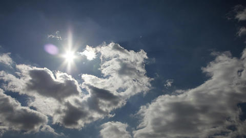 Rolling clouds with bright sun timelapse Footage