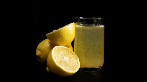 Fresh lemon juice rotating Footage