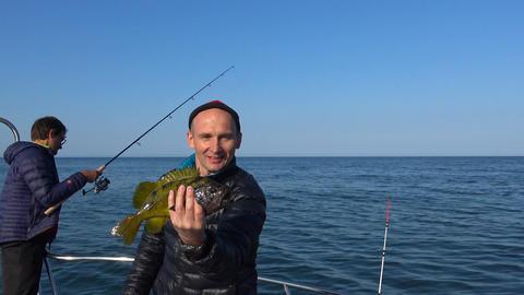 Successful fishing. Sea Safari journey along the Kamchatka Peninsula. Russia Filmmaterial