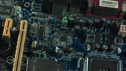 components of the motherboard closeup, sata slots and RAM, heatsink cooler Footage