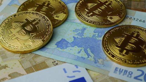 Gold Bitcoin BTC coins rotating with bills of euro Footage