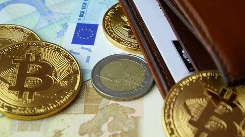 Gold Bitcoin BTC coins rotating with wallet, bills and coins of euro Footage