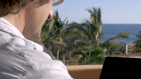 OTS of digital nomad man working at the beach on a laptop computer Footage