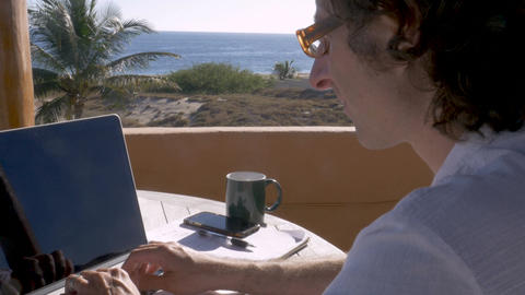 Entrepreneur man takes a short break and then continues working on his laptop ビデオ